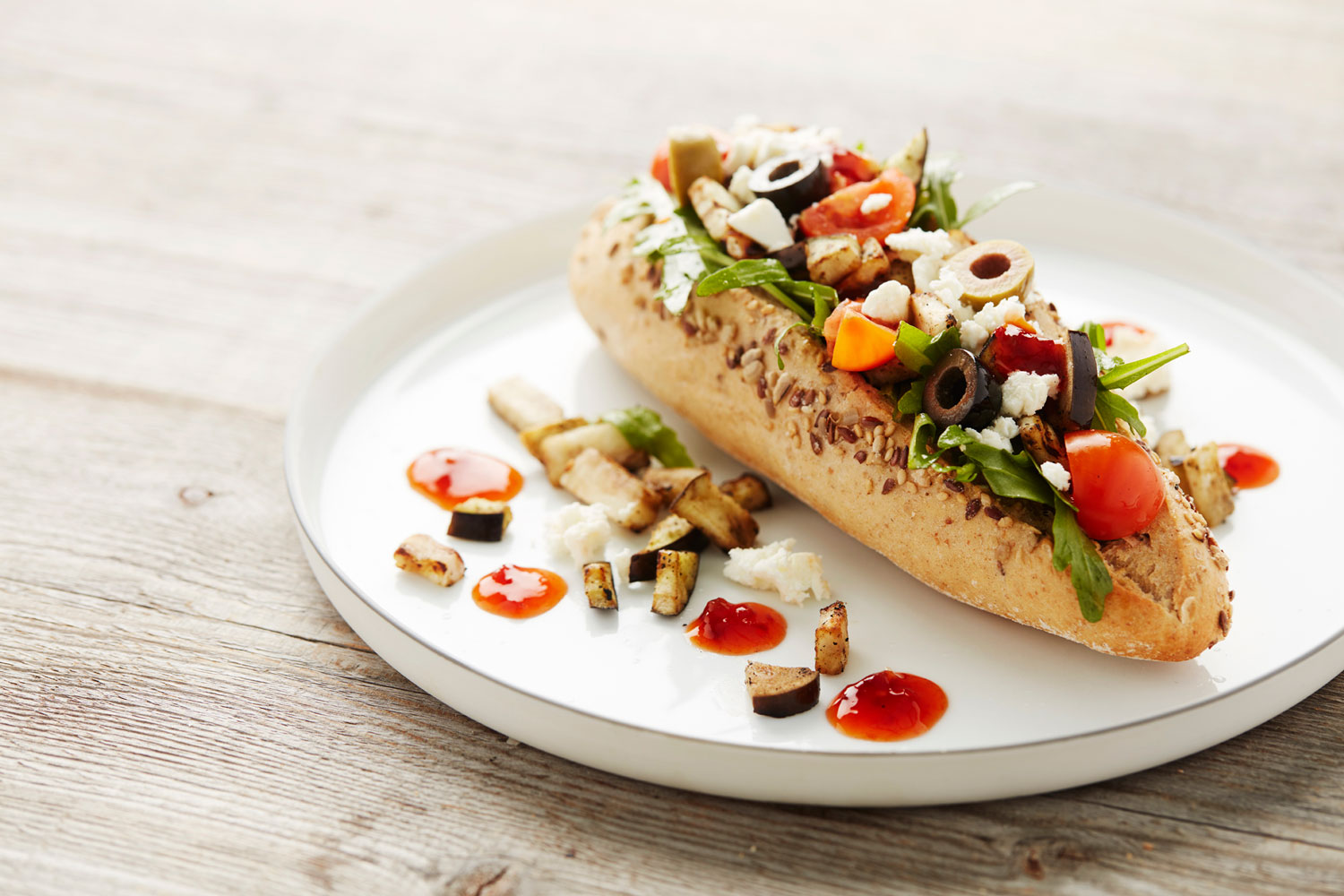 Bread roll with feta salad, chili sauce